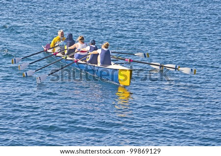 CASSIS, FRANCE - FEBRUARY 26: An unidentified group of athletes rowing in the Mediterranean sea on February 26, 2012 Cassis, France. The sport is a tradition in the region for more than a century. - stock photo