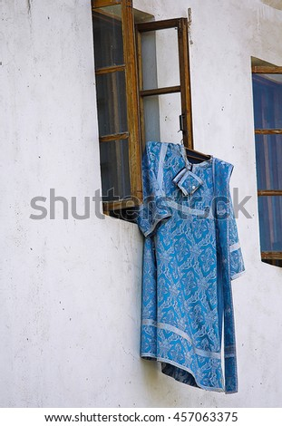 Cassock clerics posted outside. Assumption Monastery of the Caves, Crimea - stock photo