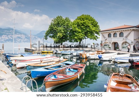 CASSONE, ITALY - JUNE 1: Marina in Lake Garda at Cassone, Italy on June 1, 2015. Lake Garda is one of the most frequented tourist regions of Italy. Foto taken from the port with view to the village.