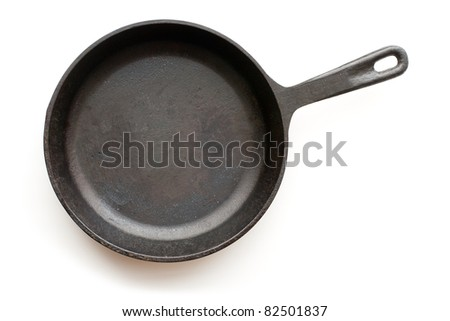 Cast-iron frying pan isolated on white background with shadow - stock photo