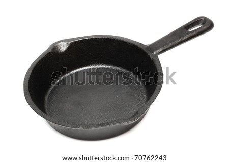 cast-iron frying pan on a white background - stock photo