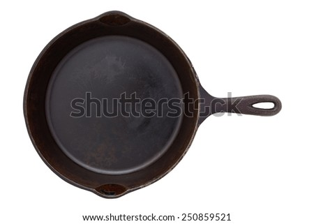 Cast iron frying pans isolated on white - stock photo