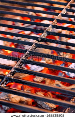 Cast Iron Grill and burning  charcoal in barbecue - stock photo