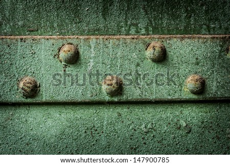 Cast iron industrial rivet rust and peeling green paint background grunge. - stock photo