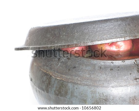 Cast iron pot with potatoes, world cuisine. - stock photo