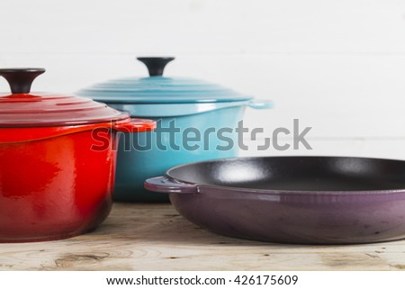 Cast iron saucepans and pan - stock photo