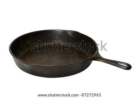Cast iron skillet isolated on white background with clipping path. - stock photo