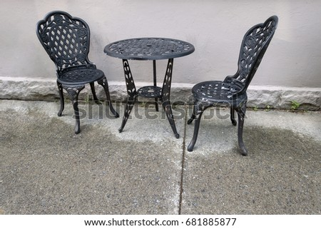 Cast iron table and chairs outside wet floor. & Cast Iron Table Chairs Outside Wet Stock Photo (Royalty Free ...