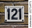 cast metal house number hundred and twenty-one - stock photo