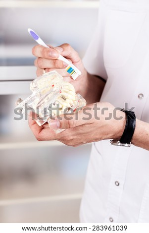 cast tooth, human - stock photo