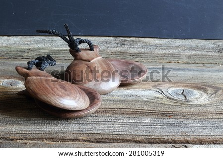 Castanets - a percussion musical instrument from wooden circles in the form of cockleshells, Two wood castanets - stock photo