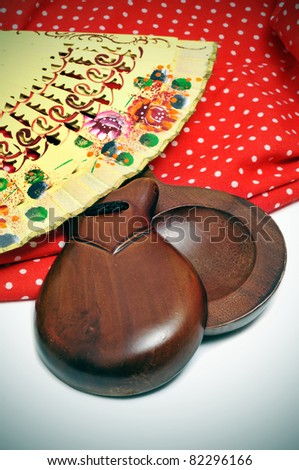 castanets, fan and flamenco dress typical of Spain - stock photo