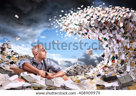 Castaway businessman in a sea of papers and files - stock photo