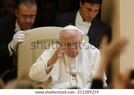 CASTEL GANDOLFO, ITALY - AUGUST 03 :  Pope John Paul II greets the pilgrims during the Angelus prayer in the courtyard of Castel Gandolfo Summer Residence, on August 03, 2003. - stock photo