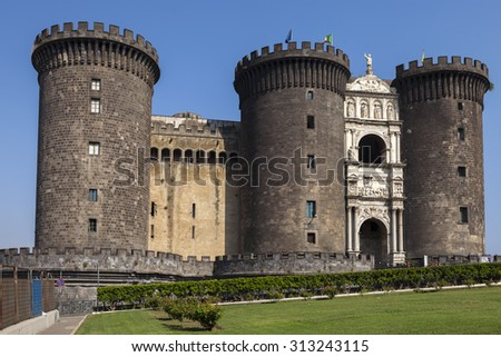 Castel Nuovo (New Castle) is a medieval castle located in central Naples, Italy. First erected in 1279, it is one of the main architectural landmarks and tourist attractions in the city. - stock photo