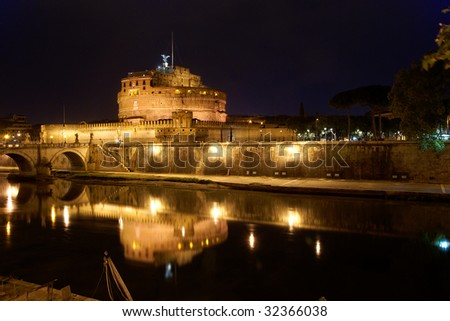 Castel Sant'Angelo in Rome by night, reflecting on Tiber river - stock photo
