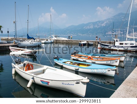 CASTELLETTO, ITALY - JUNE 2: Marina at Lake Garda in Castelletto, Italy on June 2, 2015. Lake Garda is one of the most frequented tourist regions of Italy.  - stock photo