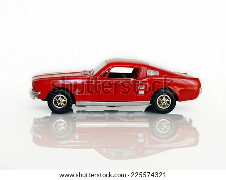 Castellon,Spain.October 24,2014.Small toy car against a white background  (Ford Mustang) - stock photo