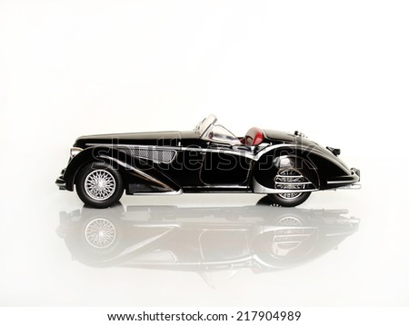 Castellon,Spain - September 17,2014: Small collectible car against white background,Alfa Romeo 8c 1938    - stock photo