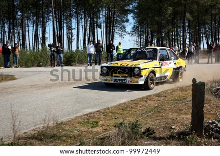 CASTELO BRANCO, PORTUGAL - MARCH 10: Eduardo Veiga drives a Ford Escort RS2000 during Rally Castelo Branco 2012, integrated on Open Championship in Castelo Branco, Portugal on March 10, 2012. - stock photo
