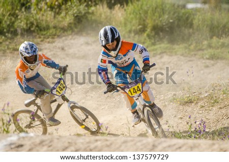 CASTELO BRANCO, PORTUGAL - MAY 4: Daniel Ferreira, on the right and Airton Paiva at the 2nd stage of the Portuguese BMX race Cup the  on may 4, 2013 in Castelo Branco, Portugal.