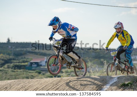 CASTELO BRANCO, PORTUGAL - MAY 4: Yuri Capetini followed by Miguel Silvestre at the 2nd stage of the Portuguese BMX race Cup the  on may 4, 2013 in Castelo Branco, Portugal.