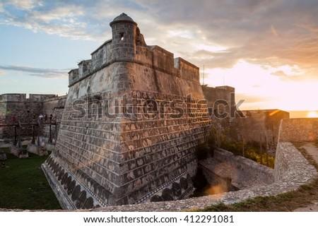 Castillo de San Pedro de la Roca (Castillo del Morro) castle during the sunset, Santiago de Cuba, Cuba - stock photo