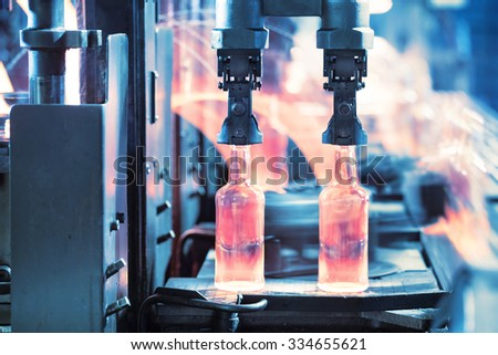 Casting glass bottles on the conveyor - stock photo
