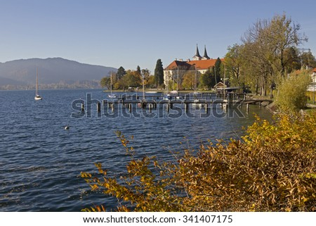 castle and brewery at lake shore tegernsee in autumn, upper bavaria. - stock photo