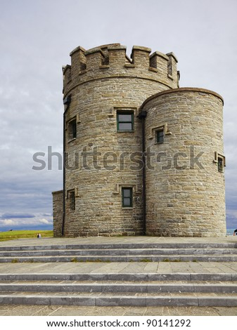 Castle at Cliffs of Moher in Ireland during summer. - stock photo