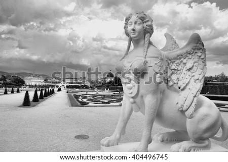 Castle Belvedere gardens in Vienna, Austria. Sphinx statue. The Old Town is a UNESCO World Heritage Site. Black and white tone - retro monochrome color style. - stock photo