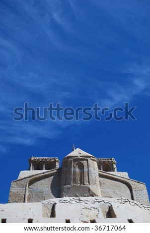 castle from sand against the blue sky in hot day. - stock photo