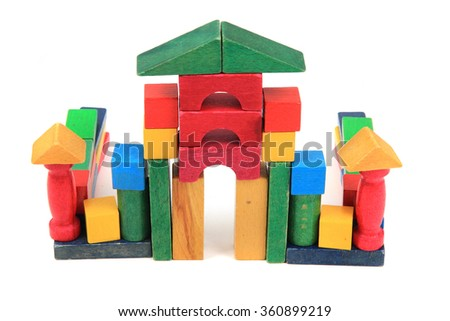 castle from wooden color bricks isolate don the white background
