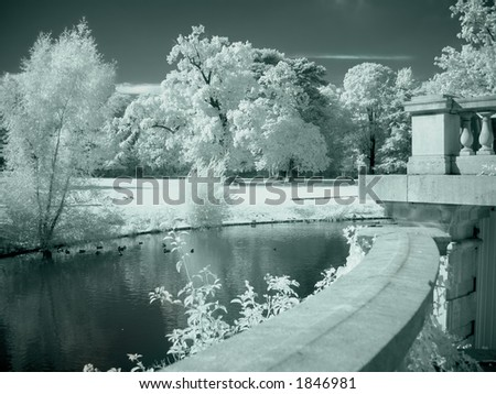 Castle garden and pond photographed in infrared (no photoshopping) - stock photo