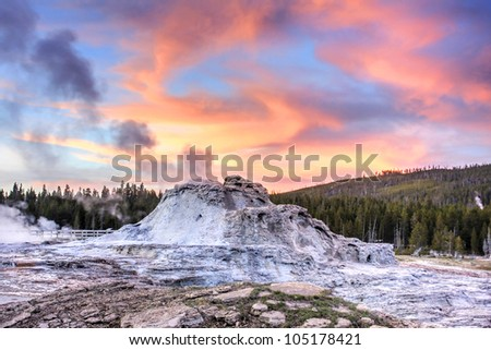Castle Geyser at sunset in Yellowstone National Park. - stock photo