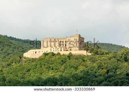 Castle Hambacher Schloss surrounded by forest - stock photo