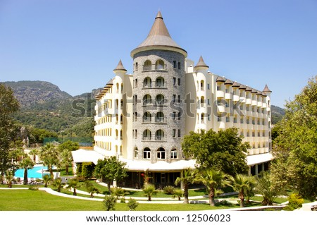 castle-hotel in mountains - stock photo