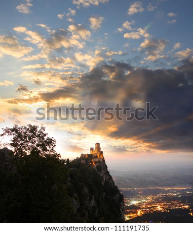 Castle in San Marino  Republic above evening town, Italy
