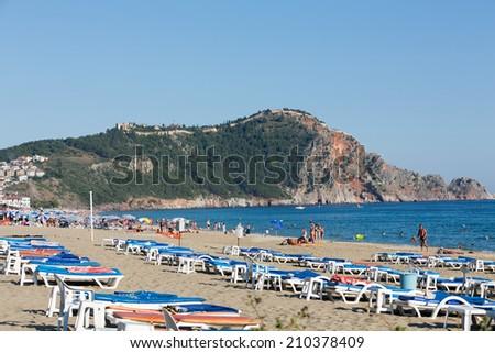 castle of Alanya built on rocks and beach of Cleopatra, Antalya, Turkey  - stock photo