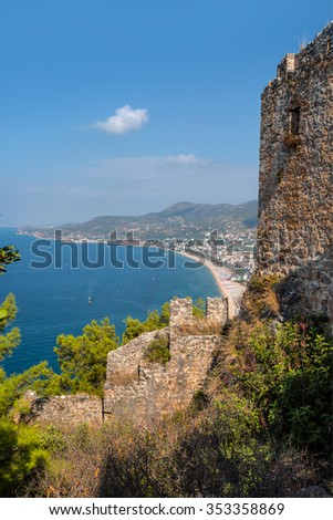 Castle of Alanya built on rocks and beach of Cleopatra, Antalya, Turkey - stock photo