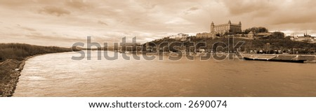Castle of Bratislava and Danube river - panorama. Sepia tone. - stock photo