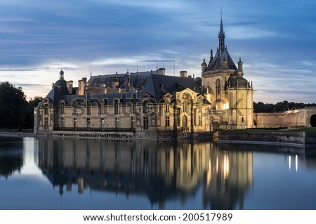 Castle of Chantilly at dusk, Oise, Picardy, France - stock photo