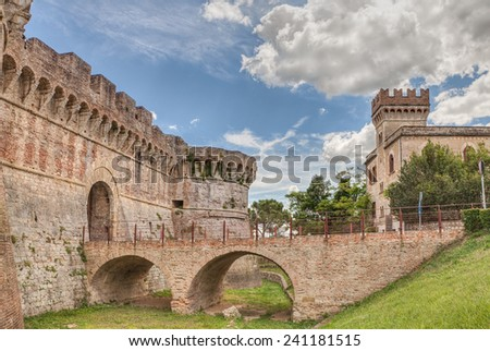castle of Colle di Val d'Elsa, Tuscany, Italy - medieval italian fortress with moat, bridge and city gate  - stock photo