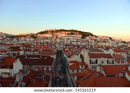 Castle of Sao Jorge (Portuguese: Castelo de S�£o Jorge) and Alfama district at sunset in Lisbon, Portugal - stock photo