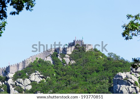 Castle of the Moors (Portuguese: Castelo dos Mouros) is medieval castle by Moors in Sintra, Portugal  - stock photo