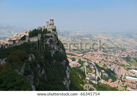 Castle on the top of rock in San-Marino - stock photo