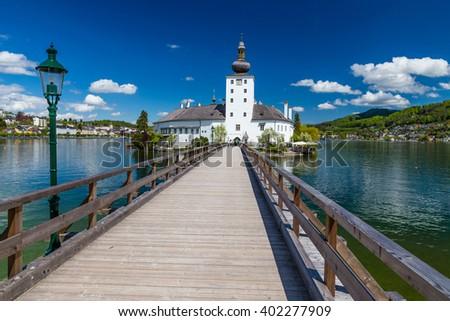 Castle Ort And Wooden Bridge Over Traunsee - Gmunden, Upper Austria, Austria, Europe - stock photo