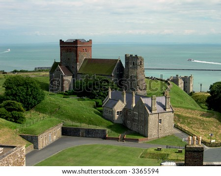 Castle overlooking sea - stock photo