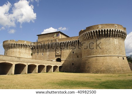 "Castle ""Rocca Roveresca"" in Senigallia, Italy on blue sky and puffy clouds background"