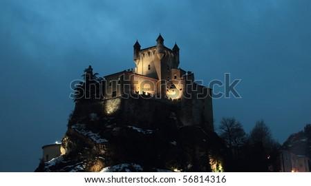 Castle St-Pierre Aosta l under a sky lurid horror films - stock photo